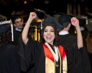 Female student cheering at NIU Commencement