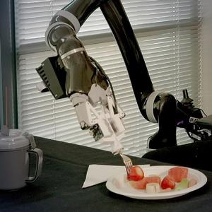 Image of robot feeding a person.